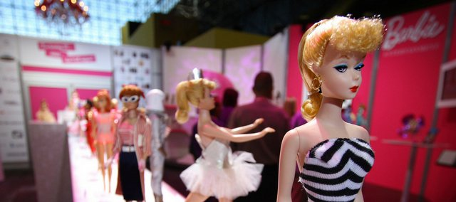 The 50th anniversary of Barbie is commemorated by a lineup of Barbie dolls from different eras, starting with the original Barbie in a black and white swimsuit, right, in a display by Mattel at Toy Fair 2009 at the Javits Center in New York.. The fair runs through Wednesday.