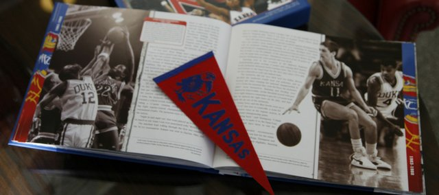 Ken Davis book about KU basketball features pullout replica pennants, tickets, contracts, notes and other memorabilia for fans to examine and enjoy.