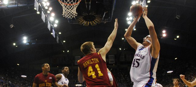 Kansas center Cole Aldrich puts in a bucket over Iowa State forward Justin Hamilton to end the first half, Wednesday, Feb. 18, 2009 at Allen Fieldhouse.