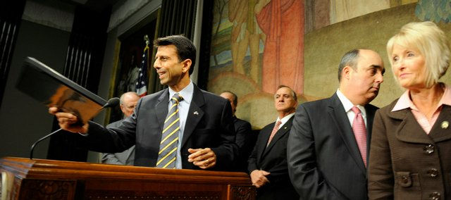 Louisiana Gov. Bobby Jindal, joined by legislators, exits a news conference Wednesday at the State Capitol in Baton Rouge, La. Jindal is considering turning down some money from the federal stimulus package.