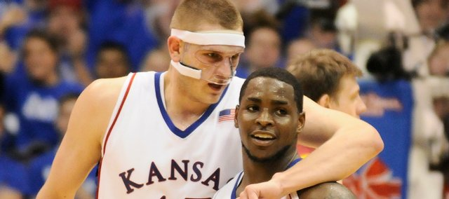 Kansas center Cole Aldrich puts his arm around guard Sherron Collins as the two make their way from the floor late in the second half against  Iowa State Wednesday, Feb. 18, 2009 at Allen Fieldhouse.