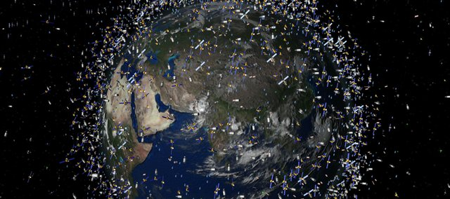 This is a computer-generated image provided by the European Space Agency showing an artist impression of catalogued objects in low-Earth orbit viewed over the Equator. Scientists are keeping a close eye on orbital debris created when two communications satellites — one American, the other Russian — smashed into each other Feb. 10 hundreds of miles above Siberia.