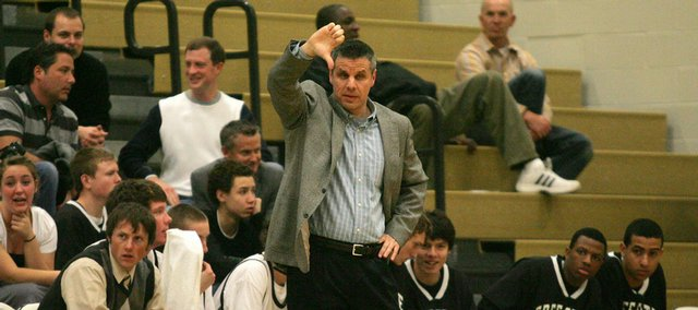 Free State boys' coach Chuck Law signals a play to his team during Tuesday night's game against Shawnee Mission North at FSHS. Law and the Firebirds are in the midst of a 16-game losing streak.