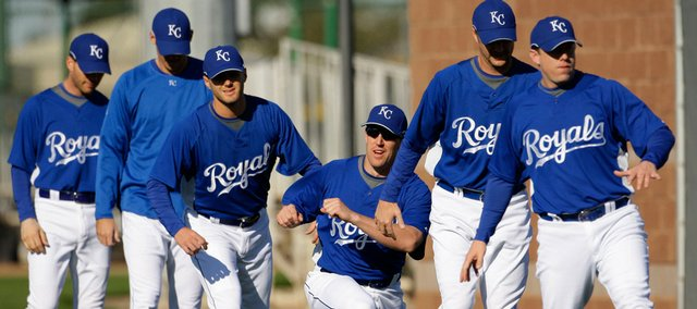 Kansas City Royals players stretch during spring training  workouts Thursday in Surprise, Ariz.