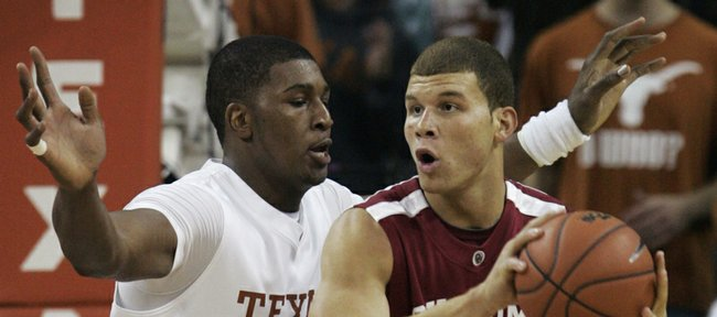 Oklahoma's Blake Griffin (23) looks to make a move against UT's Dexter Pittman on Saturday in Austin, Texas.