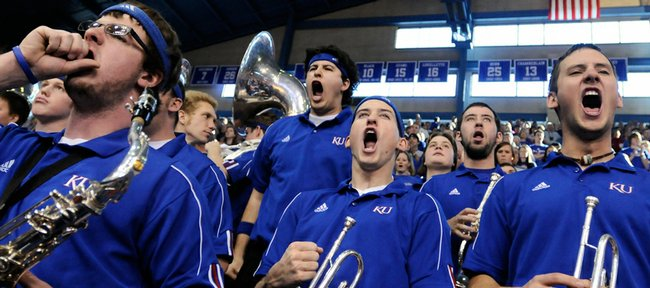 Members of the Kansas University basketball band get wild as they perform the Rock Chalk Chant prior to tipoff against Nebraska in this file photo. With the departure of the &#39;Huskers and Colorado, KU may have to change up the wording in its fight song.