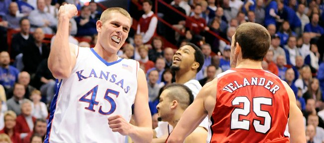 With a front tooth missing, Kansas center Cole Aldrich pumps his fist after getting a bucket and a foul with a little over a second remaining in the first half against Nebraska, Saturday, Feb. 21, 2009 at Allen Fieldhouse.