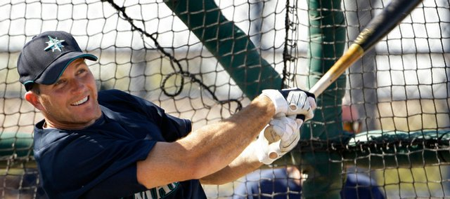 Seattle Mariners first baseman Mike Sweeney take batting practice Friday in Peoria, Ariz.