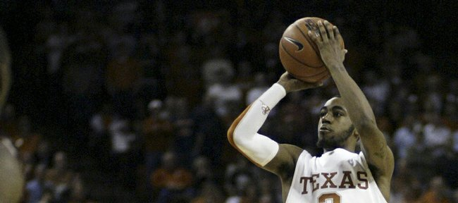 Texas guard A.J. Abrams shoots a three-pointer during the second half against Oklahoma. Abrams scored a team-high 23 points in the Longhorns' 73-68 upset of the Sooners on Saturday in Austin, Texas.