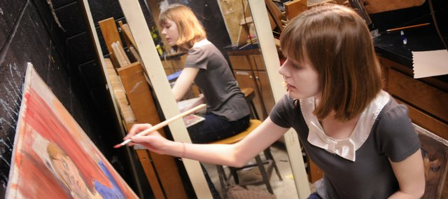 Lawrence High School senior Kristen Gish works on a self-portrait painting at LHS. Gish is the Journal-World ArtStar for February. She hopes to continue her education and study animation.