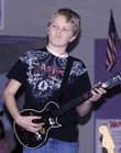 Students at Sunflower School got pumped up to take standardized tests by jamming at a Rock Band 2 concert. Price Morgan, a fifth-grader, showed his skills with the game's guitar.