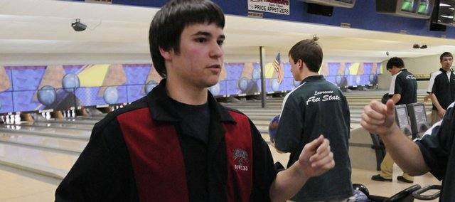Lawrence High's Ben Wyatt is congratulated after finishing with a 279 in the second game of a bowling meet between the Lions and Free State. The LHS boys won the meet Wednesday at Royal Crest Lanes.