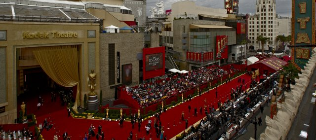 Academy Awards preparations are under way outside the Kodak Theatre in Los Angeles in this Feb. 22 file photo. Lawrence residents Sarah Arbuthnot and Shelly Cline were selected in an online lottery for bleacher seats alongside the Oscars' red carpet arrival. They then viewed the awards at the El Capitan theater across the street.