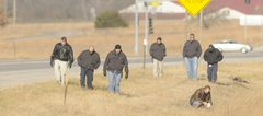 Lawrence detectives and police officers search an area near Kansas Highway 10 bypass at 27th Street and Wakarusa Drive on Tuesday morning, Dec. 2, 2008. The search was related to a sexual assault reported Monday, December 1.