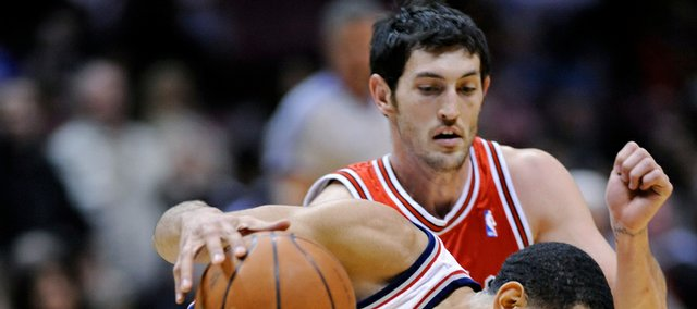Chicago Bulls' Kirk Hinrich defends against New Jersey Nets' Devin Harris during the fourth quarter of an NBA basketball game Wednesday, Feb. 25, 2009 in East Rutherford, N.J. The Nets beat the Bulls 111-99.
