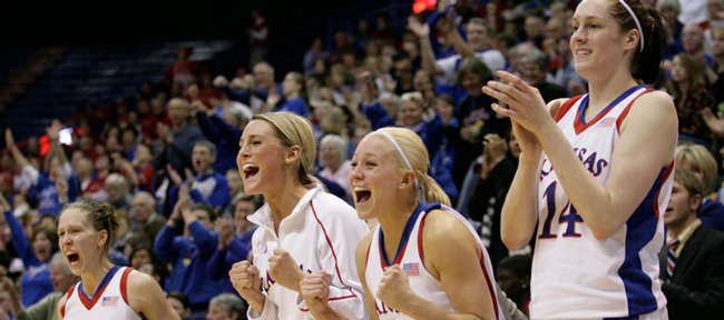 Kansas players, from left Ivana Catic, Katie Smith, Kelly Kohn and Krysten Boogaard celebrate a second half basket-and-foul by teammate Aishah Sutherland during the game Saturday, Feb. 28, 2009, at Allen Fieldhouse.