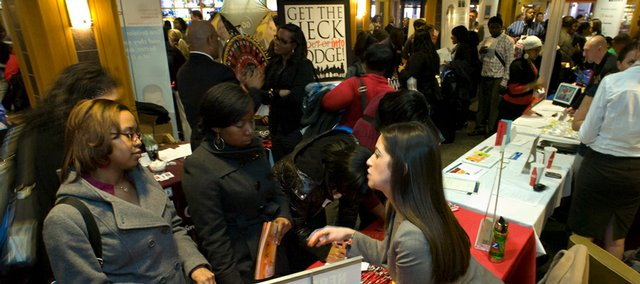 Tonika Jones, left, and Chipmpe Mpondela from Western Illinois University listen to Renee Rodriguez Batman from the University of Nebraska on Friday during the Big 12 Career Fair at the Kansas University Union. Students are facing an extraordinarily tight job market this year.