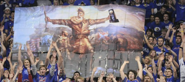 "The Jayhawk student section displays an enlarged and modified version of artist John Steuart Curry's ""Tragic Prelude"" painting, which features abolitionist John Brown holding a rifle, and in this case the 2008 National Championship trophy."