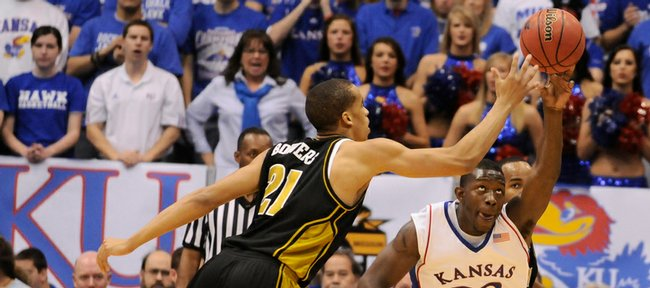 Kansas forward Mario Little pokes the ball away from Missouri forward Laurence Bowers during the second half Sunday, March 1, 2009 at Allen Fieldhouse.