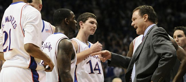 """Kansas University coach Bill Self, right, talks to his team during the Jayhawks' game against Kansas State on Jan. 13 at Allen Fieldhouse. Kansas State coach Frank Martin isn't surprised by how far the young Jayhawks have come under Self this season. Self """"is as good as it gets,"""" Martin said."""