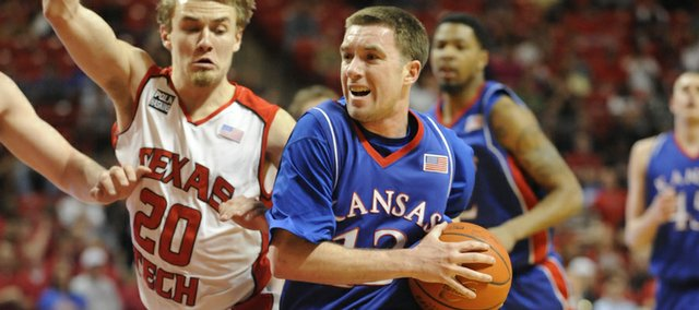 KU's Brady Morningstar drives the lane against Texas Tech's Alan Voskuil on Wednesday, March 4, 2009 at United Spirit Arena in Lubbock, Texas.