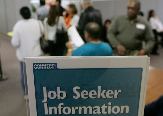 Job seekers line up for assistance Friday at an Economic Development Department office in Sunnyvale, Calif.  The Federal Reserve's new snapshot of business activity nationwide, released Wednesday, showed the economic picture darkening over the last two months and revealed little hope for a quick turnaround.