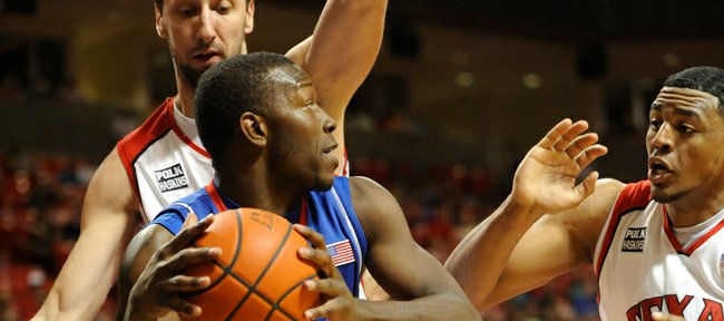 Texas Tech traps Kansas forward Mario Little during the first half on Wednesday, March 4, 2009 at United Spirit Arena in Lubbock, Texas.