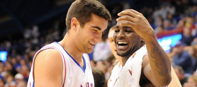 Kansas guard Sherron Collins, right, celebrates with Brennan Bechard after a three-pointer by Bechard against Coppin State during the second half Friday, Nov. 28, 2008 at Allen Fieldhouse.