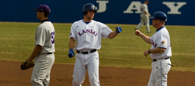 Kansas Freshman Zac Elgie, center, accepts congratulations after singling in the seventh inning of the first game of KU's doubleheader with Northwestern. The Jayhawks swept the twinbill, 9-8 and 7-3, on Friday at Hoglund Ballpark.