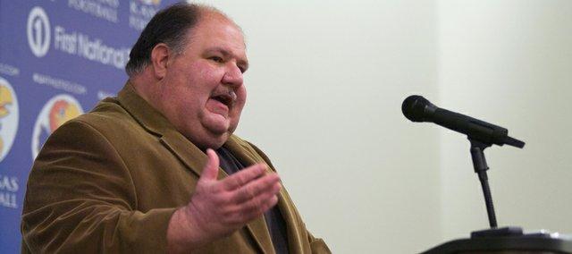 KU coach Mark Mangino speaks with members of the media on Friday at Mrkonic Auditorium.