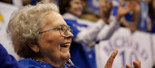 "Marjorie ""Marge"" Smith, 96, watches watched the Kansas Jayhawks take on and defeat the Texas Longhorns on Saturday."