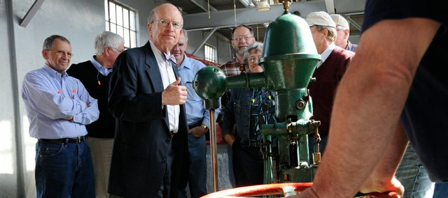 Stephen Hill, president of Bowersock Mills &amp; Power Co., left of center, gives a tour of the facility on the Kansas River to members of the House Energy and Utilities Committee. The group also toured the Lawrence Energy Center on Friday. 