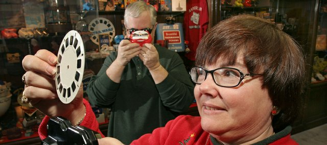 Mary Ann Sell loads a View-Master photo reel into a viewer from her collection at her Maineville, Ohio, home.