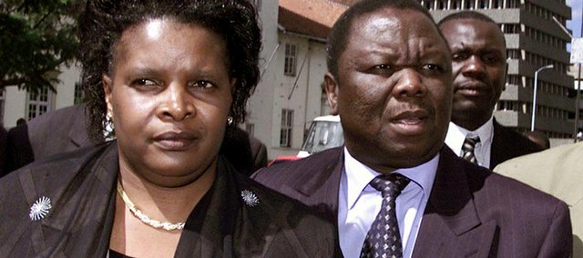 In this Feb. 3, 2003, file photo, Morgan Tsvangirai, right, arrives at the Harare High Court, accompanied by his wife Susan, left. Zimbabwean Prime Minister Morgan Tsvangirai's spokesman says the premier was hurt in a car accident, and that the injuries are not life-threatening.