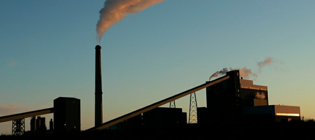 In this Feb. 7, 2007, file photo, Sunflower Electric Cooperative's coal-fired power plant churns out electricity in Holcomb, Kan.