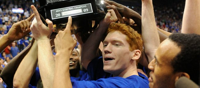 Senior Matt Kleinmann points at the Big 12 championship trophy after the Jayhawks defeated Texas 83-73 in KU's final regular-season game, and last game of the season in Allen Fieldhouse on Saturday, March 7, 2009.