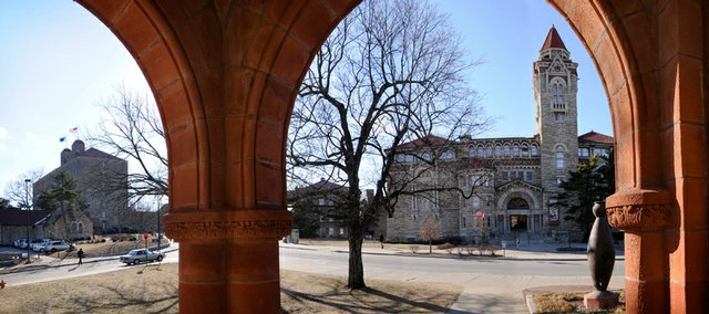Viewed through the front arches of Spooner Hall is Dyche Hall, right of center. At left, in the distance, is Danforth Chapel and Fraser Hall.