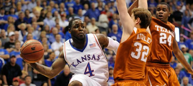 Kansas guard Sherron Collins looks to pass against the Texas defense on Saturday, March 7, 2009 at Allen Fieldhouse.
