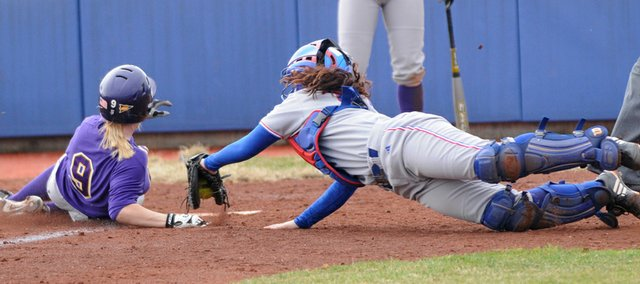 Kansas catcher Elle Pottorf can't make the tag on a Northern Iowa runner in the seventh inning in the first game of a doubleheader. KU lost to Northern Iowa, 8-5, then defeated Eastern Illinois, 4-2, on Saturday at Arrocha Ballpark.
