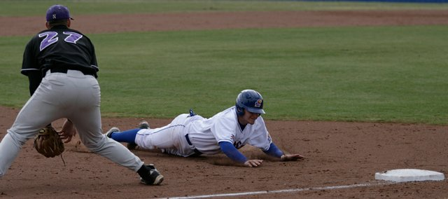 Kansas' James Stanfield slides safely into third base during the game against Northwestern on Sunday, March 8, 2009, at Hoglund Ballpark.