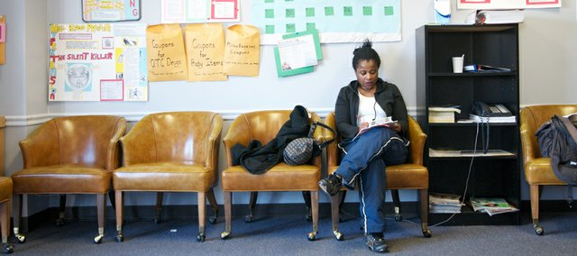 Deauma Clemons, Lawrence, fills out a patient information form at 1920 Moodie Rd. Thursday, March 5, 2009. Clemons, who has used the clinic in the past was visiting the clinic to help address a cold she was battling.
