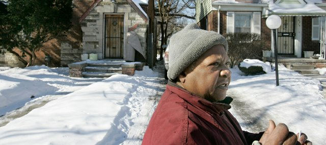 "Resident Novella Willis talks about the state of her neighborhood last month in west Detroit. Willis, a longtime resident of Cruse Street, soon will have her mortgage paid off, but she is among those caught in the changing market. ""None of these houses are selling. None of them,"" she said. ""If you go down to the next block you'll see a lot of foreclosures all around here."""