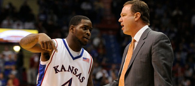All-Big 12 first-team guard Sherron Collins, left, talks with Big 12 coach of the year Bill Self in this file photo from Nov. 28, 2008.