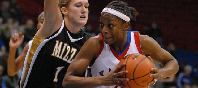 Kansas University junior Danielle McCray, right, goes up against Missouri's Bekah Mills in the Jayhawks' victory on January 14 at Allen Fieldhouse. McCray was named to the All-Big 12 first team on Monday, becoming the fourth KU women's player to earn that honor.