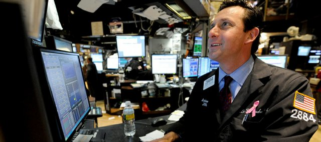 Andrew Mayers of LaBranche & Co. works on the floor of the New York Stock Exchange, Tuesday in New York. Led by financial companies, the market made its first big move upward in weeks Tuesday after Citigroup Inc. said it had operated at a profit during the first two months of the year.