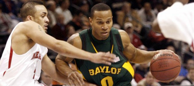 Baylor's Curtis Jerrells (0) drives the ball around Nebraska's Steve Harley (4) in the second half at the Big 12 Conference men's tournament in Oklahoma City, Wednesday, March 11, 2009.