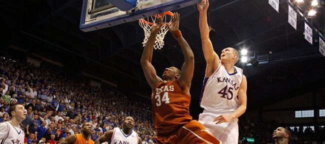 Kansas University's Cole Aldrich (45) tries to block the shot of Texas' Dexter Pittman (34) last Saturday in Allen Fieldhouse. Aldrich's production has been a bit down of late, but the Minnesota native said it hasn't been because of minor injuries.