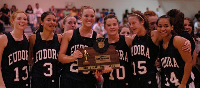 The Eudora High seniors pose with the Class 4A sub-state championship trophy last Saturday in Eudora. The Cardinals beat St. James, 42-25, to advance to the Class 4A state tournament this week in Salina. Pictured, from left, are Mariah Webb, Bailey Scott, Haley Epperson, Rachel Pyle, Kendal Abel and Tianna Dunnaway.