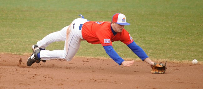 Kansas University shortstop David Narodowski dives for a ground ball in the third inning. KU defeated Missouri Valley, 10-3, on Tuesday at Hoglund Ballpark.