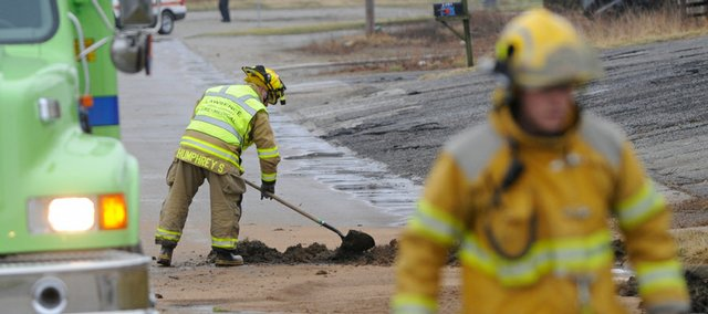 Officials investigated the area of 22nd and Delaware streets on Tuesday after an oily sludge was discovered in the area. A portion of Delaware Street was closed during the investigation.